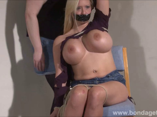 Tape gagged German fetish model Melanie Moons bondage