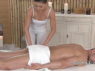 Sexy masseuse oils and  wanks cock