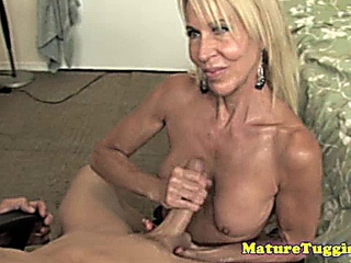 Blonde cougar milf beating him off