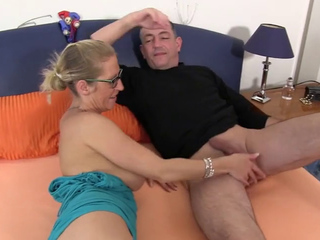 Busty mature German blondie Jana L enjoys two cocks