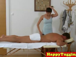 Busty asian masseuse jerking on client
